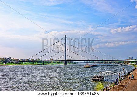 Oberkasseler Bridge And Rhine Embankment Promenade In Dusseldorf