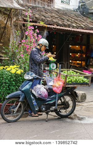 Asian Trader With A Motor Bicycle Selling Fresh Chayote