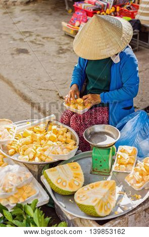Asian Woman Selling Flesh Of Cleaned And Packed Durian