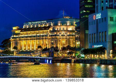Fullerton Hotel Building At Marina Bay In Singapore At Night