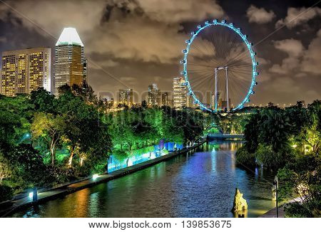Singapore Flyer And Skyline Of Downtown Core At Marina Bay