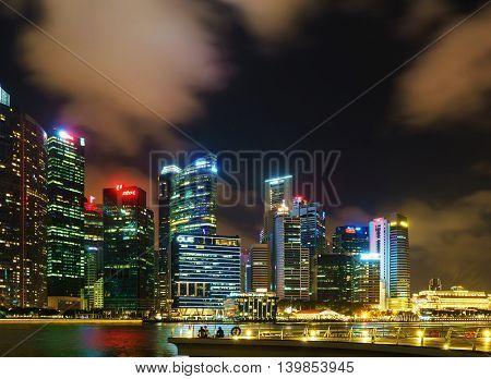 Singapore Skyline Of Downtown Core On Marina Bay At Dusk