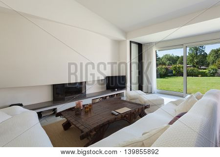 Modern house, living room with white divans, interior