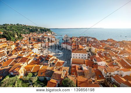 Beautiful aerial view on Piran town with Tartini main square, ancient buildings with red roofs and Adriatic sea in southwestern Slovenia