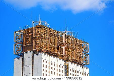 MOSCOW, RUSSIA- JUNE 06, 2013: Russian Academy of Sciences, Moscow, Russia. This building is called The Golden Brain due to the metal part on the roof of the building