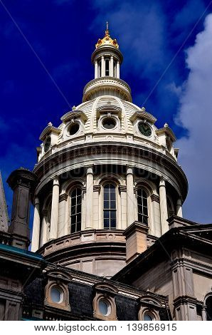 Baltimore Maryland - July 22 2013: Elegant dome with cupola atop 1867 Baltimore City Hall
