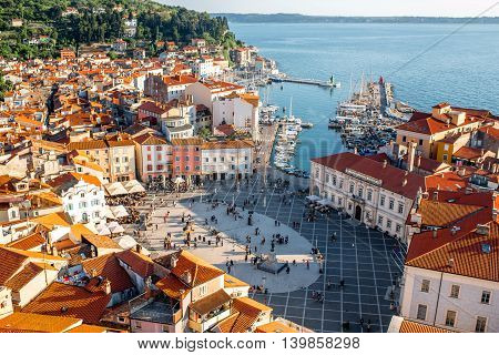 Beautiful aerial view on Piran town with Tartini main square, ancient buildings with red roofs and Adriatic sea in southwestern Slovenia poster