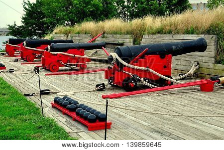 Baltimore Marland - July 24 2013: 18th century cannons mounted on wooden trolleys face Chesapeake Bay at Fort McHenry National Historic Park