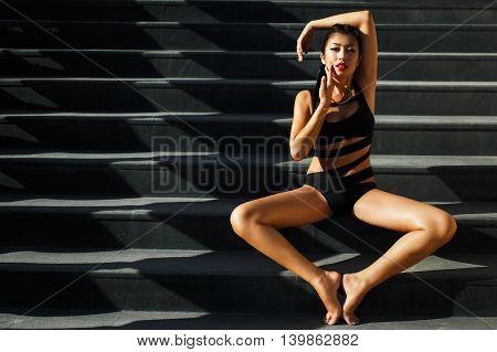 beautiful Asian girl in a black bathing suit