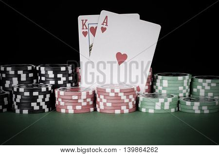 King, Ace, Black, Red And Green Casino Chips On Table - Vintage