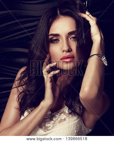 Sexy Makeup Female Model Touching Her Face Manicured Fingers With Fashion Bangle On The Hand On Blac