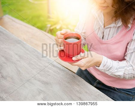 Women Holding Red Coffee Cup In Hands.