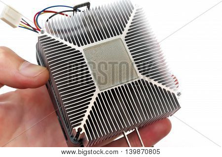 Computer Cpu Heatsink And Thermal Paste In Hand