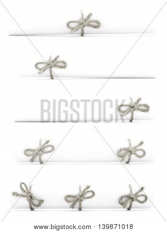 White paper scrolls tied with natural cords and bows isolated