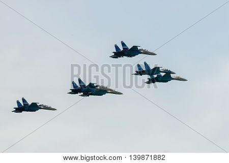Nizhniy Tagil, Russia - July 12. 2008: fighters SU-27 display of fighting opportunities of equipment with application of aviation means of defeat. RAE exhibition. Russia Arms Expo
