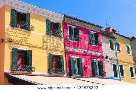 Burano, Venice, Italy - May 10, 2014: Colorful old houses on the Island of Burano near Venice, Italy