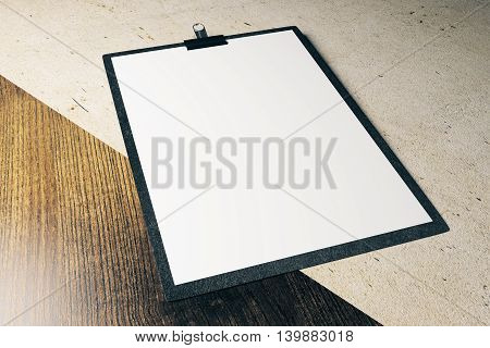 Closeup of blank clipboard on wooden and concrete surface. Mock up 3D Rendering
