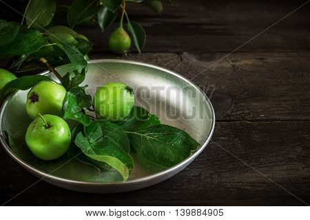 Fresh Green Apples With Leaves On Dark Rusric Background.