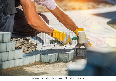 Garden Brick Pathway Paving by Professional Paver Worker. poster