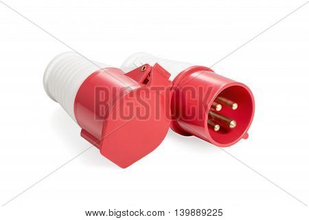 Red and white three-phase plug and socket with a lid lying beside isolated on white background