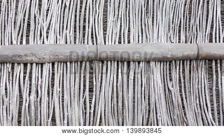 old gray wall partition of large and small dilapidated dry brittle bamboo