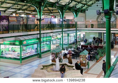 SOFIA, BULGARIA - MARCH 4, 2016: People in the Central Sofia Market Hall. The market hall was opened in 1911 and is today an important trade center in the city