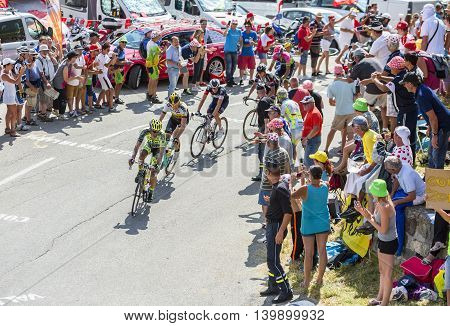 Col du Glandon France - July 23 2015: Alberto Contador of Tinkoff-Saxo Team riding in front of a group of cyclists in a beautiful curve at Col du Glandon in Alps during the stage 18 of Le Tour de France 2015.