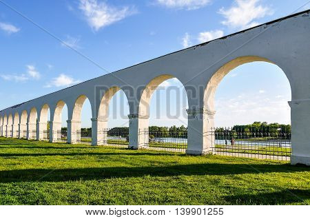 Architecture landscape - arcade of the ancient Yaroslav's courtyard at summer sunset in Veliky Novgorod Russia poster