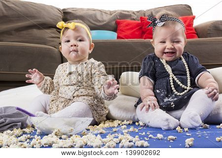 messy food feeding babies popcorn and yoghurt