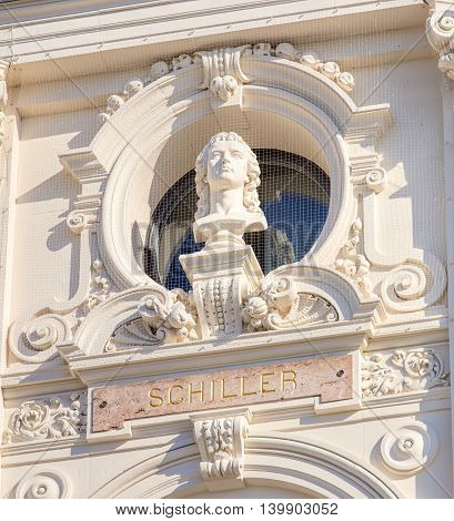 Zurich, Switzerland - 20 July, 2016: bust of Schiller on the facade of the Zurich Opera House building. Zurich Opera House has been the home of the Zurich Opera since 1891. It also houses the Bernhard-Theater Zurich and the Zurich Ballet.