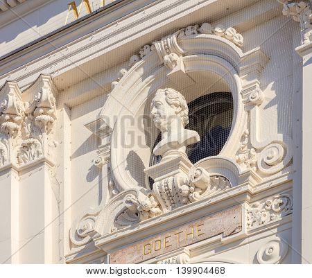 Zurich, Switzerland - 20 July, 2016: bust of Goethe on the facade of the Zurich Opera House building. Zurich Opera House has been the home of the Zurich Opera since 1891. It also houses the Bernhard-Theater Zurich and the Zurich Ballet.