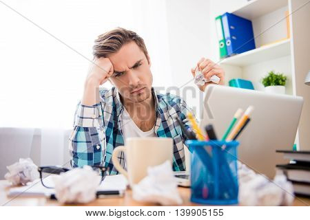 Depressed Man Without Idea Holding Crumpled Paper