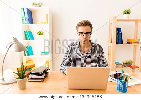 Portrait Of Serious Young Writer Working On New Book