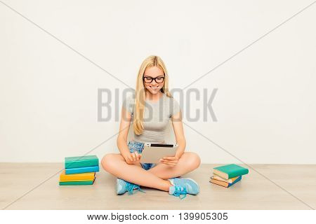 Smart Happy Girl Preparing For The Exams And Using Tablet