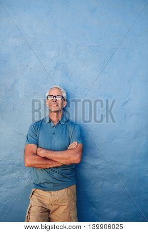 Confident Mature Man Looking Up At Copy Space