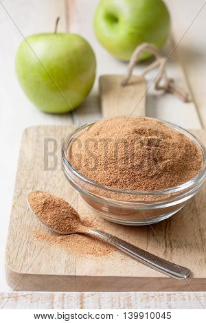 crushed apple fiber green apples on a light wooden background. dietary product