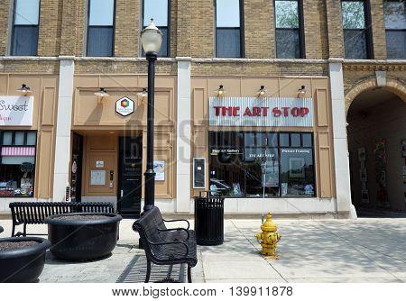 LA GRANGE, ILLINOIS / UNITED STATES - MAY 21, 2016: One may purchase fine art work at the Art Stop in downtown La Grange, Illinois.