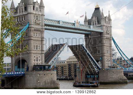 London Tower Bridge opening lift vessel passing