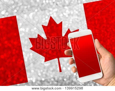 canada flag on bokeh background with copy space on smartphone