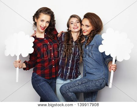 stylish girls best friends holding blank paper on stick.