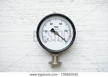pressure gauge on white old wood background