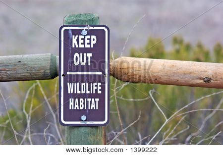a keep out wildlife sign close up poster