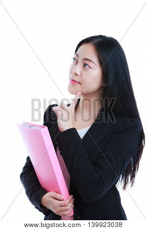 Successful asian woman looking confident thoughtful. Businesswoman holding document folder and looking up isolated on white background. Studio shot.