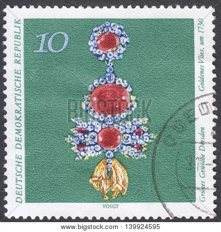 MOSCOW RUSSIA - CIRCA FEBRUARY 2016: a post stamp printed in DDR shows a brooch the series