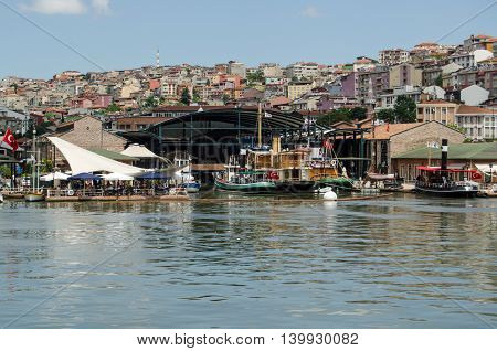 ISTANBUL TURKEY - JUNE 5 2016: Historic boats on exhibition at the Rahmim Roc Museum of transport in the Beyoglu district of Istanbul Turkey on a sunny afternoon in June.