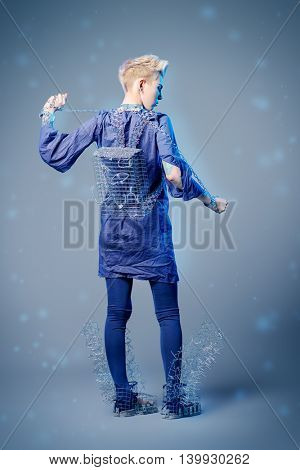 Full length fashion portrait of a model performing designer collection with the use of metal wire. Avant-garde style. Futurism. Studio shot.