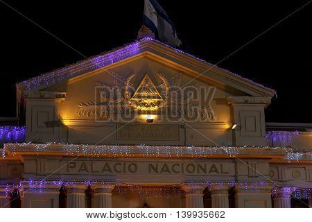 Managua Nicaragua. National Palace View at night with nicaraguan flag