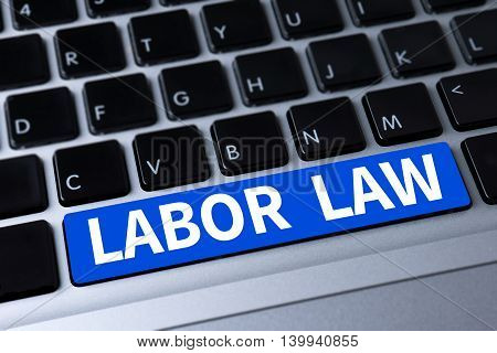 LABOR LAW a message on keyboard computer top