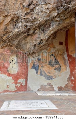 July 17, 2016-Benedictine monastery of Subiaco in Lazio-Italy-the burial of Jesus Christ in a fresco from author unidentified embedded in rock of the Benedictine monastery of Subiaco