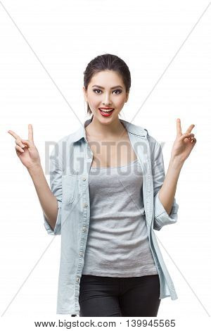 Portrait of happy smiling young cheerful woman, showing two fingers or victory gesture, on white isolated background. Young woman Asian Caucasian students